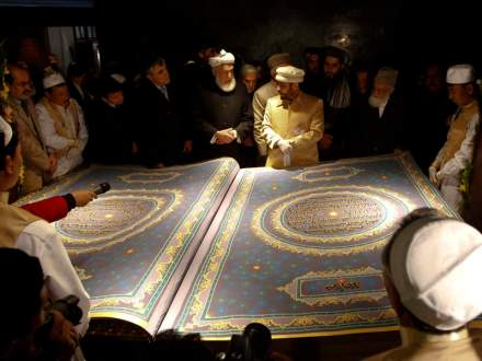 Calligrapher Khedri gives information about the biggest Koran in the world to Afghan officials during its inauguration ceremony in the Hakim Nasir Khosrow Balkhi library in Kabul